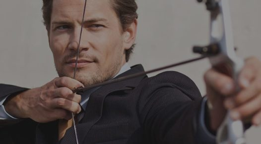 man shooting arrow